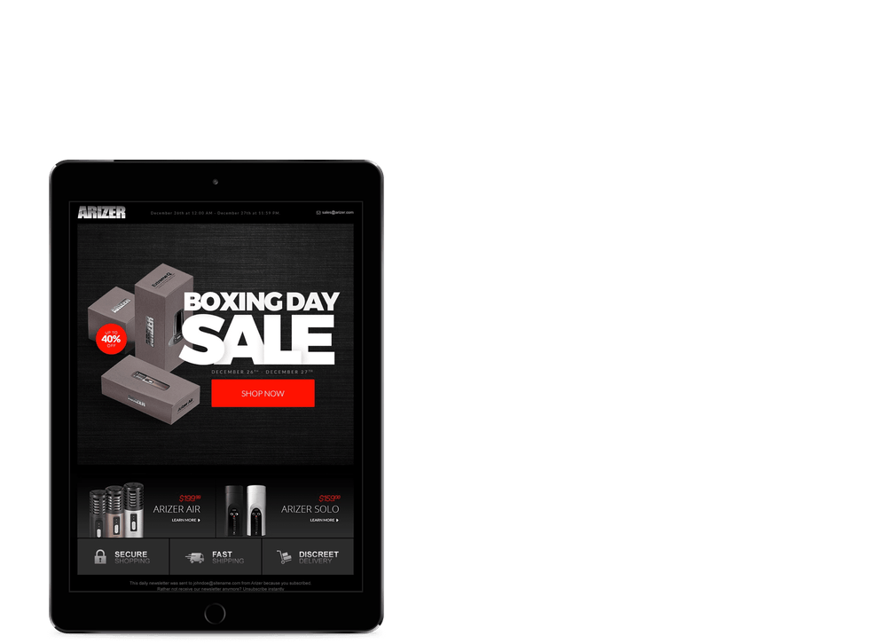 tablet showing a boxing day email with a black background and white text